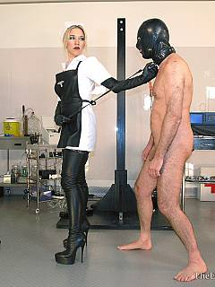 Kinky fun of binding a man with plastic tape and then applying suction tube to his exposed penis