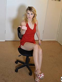 Sexy MILF is busy working with documents but she will take a pause to spank and paddle you OTK