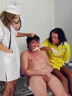 Dude is having his mouth gagged and his cock taken over by nyloned feet during medical examination