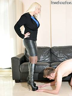 Shoe licker is getting slapped  in his face after cleaning up mistress boots