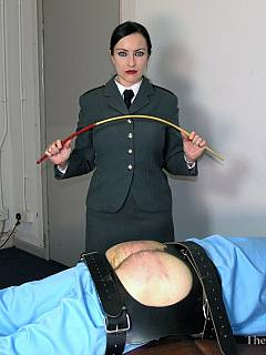 Bitch in uniform is entering cell to whip and cane the prisoner