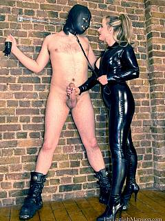 Busty bitch in rubber is enjoying her new slave: building a list of tortures to be performed in her head