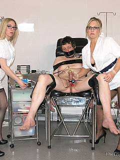 Dude is exposed in front of a couple of sexy nurses: strapped to the medical chair and having his unprotected cock and balls ready for bizarre tortures