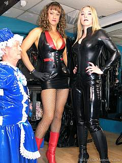 Ladies in leather are stretching old sissy slave on the BDSM rack