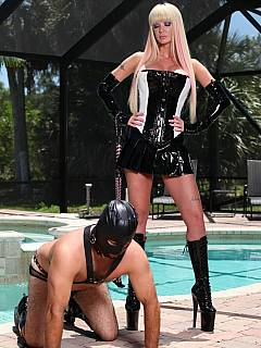Classy blond is ready to punish petboy with whipping while wearing sexy PVC dress and a pair of high heel boots