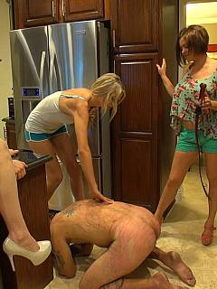 Bitchy redhead is in need of help of two girlfriends when whipping and kicking her handcuffed husband