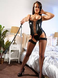 Enjoy the feeling of being controlled by a sexy girl in laced PVC lingerie and with a riding crop in her hands