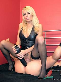 Merciless blond handcuffed her slave in spread pose so his ass is now exposed to any kind of toy insertions