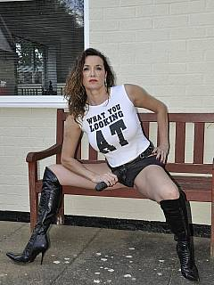 T-shirt, panties and a apir of high heel boots are making femdom lady look like a slut - a very sexy and desirable slut