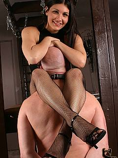 Tiny dominatrix is pointing bald slave the places all over her feet she wants to be kissed and worshiped