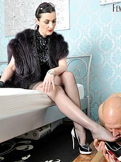 Gorgeous lady is dressed up elegant in the scene where she is teasing cock and slave is thanking her by worshiping hot legs
