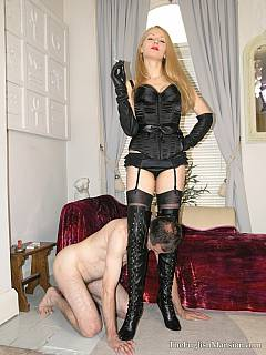Petboy is fully controlled by the gorgeous dominatrix: licking her boots, swallowing spits and enjoying being slapped in the face