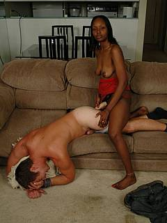 Black babe is taking over the white man: put him into doggy style pose and using strap-on onto his ass