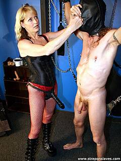 MILF domme is keeping her slave with the black leather mask over his head while she is using jelly cock to penetrate is holes