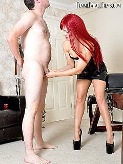 Steel toys are helping redhead bitch to control her slave: his cock is in the chastity tube and chain leash is attached to his collar