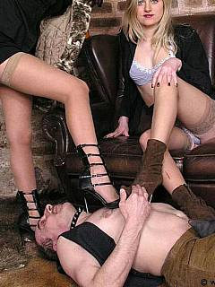Dude becomes a foot rest for a couple of leggy girls in nylon stocking and high heel shoes