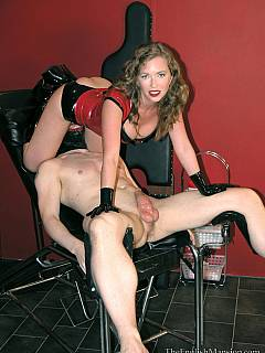 DOminatrix is crawling all over the exposed femdom slave making sure her pussy is in close contact with his face and her knee is resting onto his balls