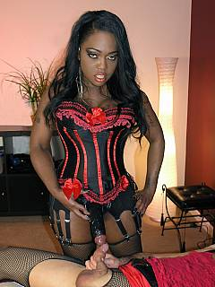 White sissy is educated nicely by a black dominatrix: dressed up in lingerie, feminized and educated with monster strap-on