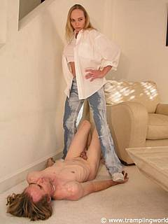 Sporty footwear and jeans are totally OK in case woman wants to dominated a slave with cock trampling