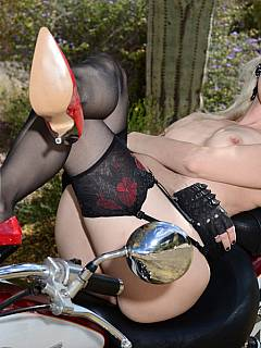 Leggy femdom Goddess loves feeling something powerful in between her legs: big shiny bike is perfect for her to pose on