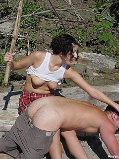 Femdom couple is on the outdoor mission: male is over the girl knee and punished with all sorts of kanning