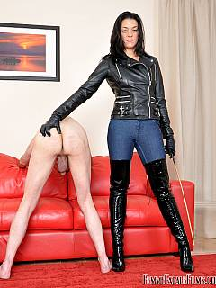 Naked sub has to work hard licking knee-boot dominatrix is wearing to gain the privilege of getting caned by this beautiful woman
