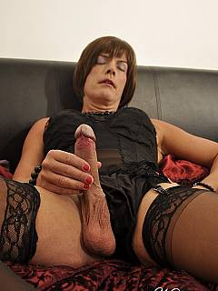 Close-up photos of feminized slave is enjoying the touch of nyloned female feet to his vovk