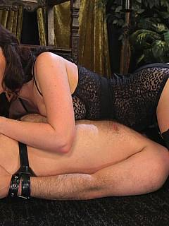 Slave became a floor mat for the leggy Goddess: his balls and ass are violated during the foot worship session