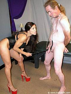 Cruel babe making sure the pain is extreme when putting balls into BDSM harness, canning them and kicking with her feet