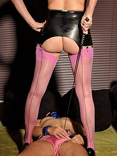 Femdom sissy is wearing pink panties, kissing dominatrix feet and then having his penis trampled with high heels