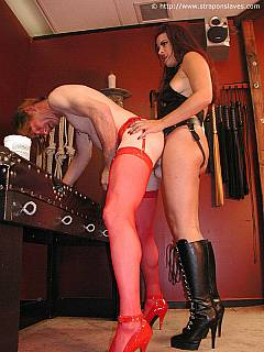 Sissy loves when hot woman is penetrating his ass with big strap-on while he is wearing slutty red stockings and heels