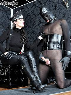 Pantyhosed slave is educated by gorgeous woman in full-body leather military costume: cock-teased and put into femdom submission