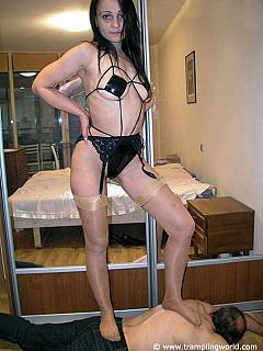 Dude is enjoying slut in extremely kinky lingerie and a pair of seamed nylons walking all over his back