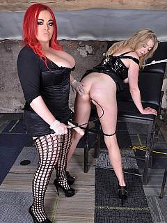 Bitchy plumper is having another chubbytied to medical chair and violated with strap-on cock
