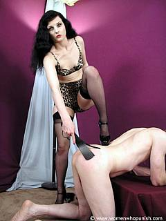 Spanking and paddling punishments of naked man is performed by pin-up style dominatrix in leopard bikini