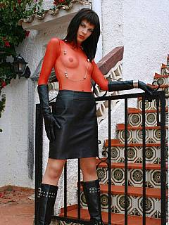 Fetish Goddess is out on the stairs making herself look like a slut in black leather and wearing red undies