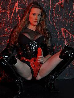 Classy dominatrix is using that Terminator-type of look when posing with one of the sex toys attached