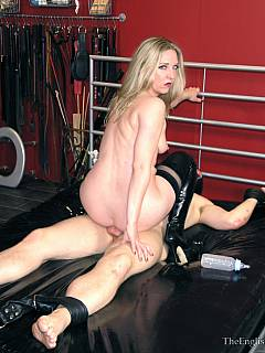Spread-eagled slave is teased with dominatrix rubbing her pussy against his cock but he is peeind all oved by the bitch instead of cumming