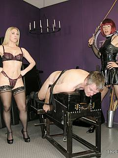 Dude is subjected to hardcore femdom canning by beautiful dominatrix and her feminized slave