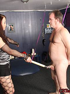Cruel girl spread fat man sideways with cuffs and tormenting his exposed penis in any way she likes: beating up, tickling and clamping