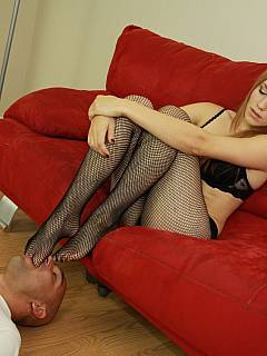 Redhead girl in fishnets is having her toes sucked and soles licked by bald man