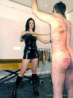 Lady allowed slave to lick her boots before handcuffing him and lashing violently with the whip