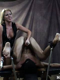 Bizarre BDSM rack is holding exposed an firmly so crazy bitch could play with his unprotected penis and balls