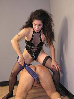 Curly girl is wearing kinky PVC lingerie in the scene where she is paddling naked guy