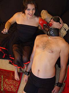 Collared and leashed slave is there to pleasure young mistress with toes sucking and polishing her shoes with licking