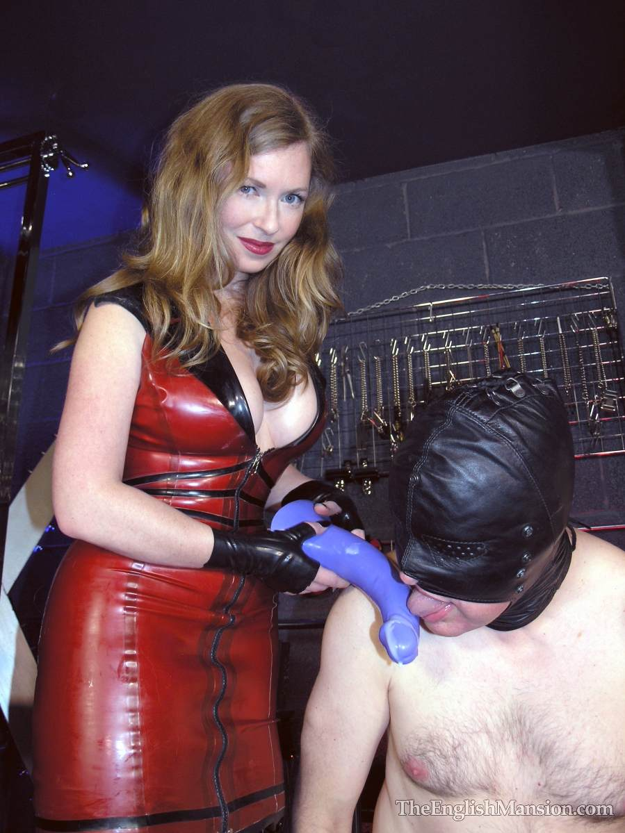 Picture #18 of Hot girls in latex are joinint their efforts to teach a couple of femdom slaves to suck each other dicks