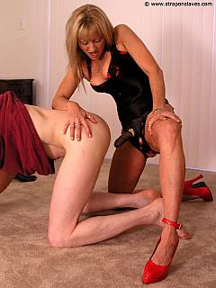 Male is put in doggy pose and there is hot blond ramming him from behind with strap-on cock