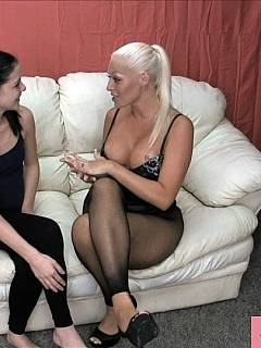Two sexy bitches are working as a team busting balls with foot kicks