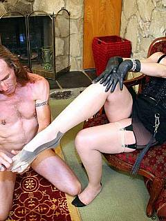 Kneeling dude has to take off nylon stockings to get access to mistress bare feet