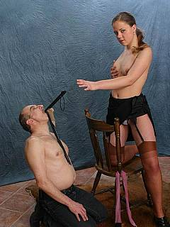 Kinky lady placed nylons around slaves' head and is going to smother him with her juicy ass